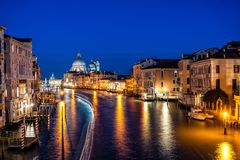 Night view of typical canal and gondolas in Venice, Italy. stock images