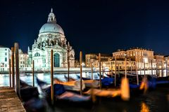 Night view of typical canal and gondolas in Venice, Italy. stock image