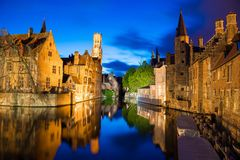 Night shot of historic medieval buildings along a canal in Bruges, Belgium. Bruges, Belgium - April 17, 2017: Night shot of historic medieval buildings along a Stock Photography