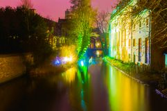 Night shot of historic medieval buildings along a canal in Bruges, Belgium. Night image of historic medieval buildings along a canal in Bruges, Belgium Royalty Free Stock Photos