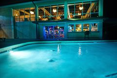 A night shot of a hotel swimming pool. stock images