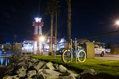 Oceanside Harbor Lighthouse & Bicycle Stock Photo