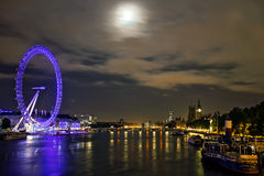 London Skyline. Night shot of the London Eye, Big Ben and Victoria Embankment, August 3, 2012. Its the iconic london landscape and the main tourist attractions Royalty Free Stock Photography