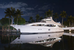 Night shot of luxury yacht. With reflection in the water Stock Images