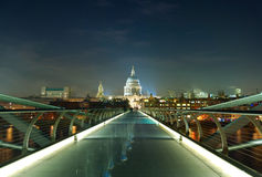 Night shot of the millennium bridge over the river Thames in Lon Stock Images