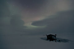 Night shot of northern lights in frozen winter country Stock Images