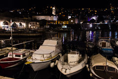 Night shot of Old port and arsenal in Dubrovnik, Croatia. DUBROVNIK, CROATIA - JULY 19, 2016: night shot of leisure and fishing boats docked at Old Town`s Old Royalty Free Stock Photos