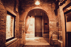 The night shot of red brick arch door, apply gain noise filter stock images