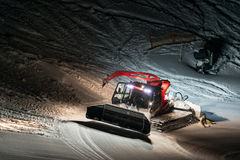 Night shot of red snow groomer Stock Photography