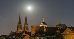 Night shot of Regensburg with moon beside the cathedral Royalty Free Stock Photos