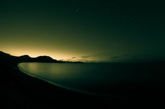 Night shot of sea. Toned. Stock Image