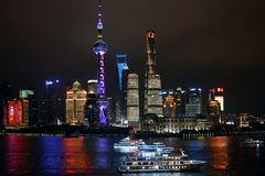 Night shot of Shanghai skyline and tour boats Stock Photography