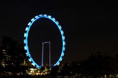 Night shot of the Singapore Flyer ferris wheel. Singapore - December 2, 2014: A night photograph of the slowly rotating Singapore Flyer attraction. The 165 meter royalty free stock photo