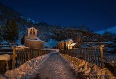 Night shot snowy mountain village stock photography