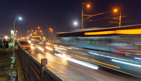 Night shot with strong intentional motion blur from traffic over a bridge in Turkey. stock photography