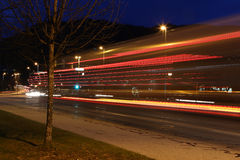 Night shot of traffic with Starbucks coffee building Stock Photos