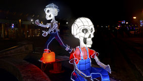 Night shot of two skeleton sculptures lighten from inside royalty free stock image