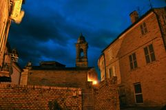 Medieval village of Mogliano in central Italy. Night shot of typical medieval architecture in the village of Mogliano. Marche region, central Italy royalty free stock images