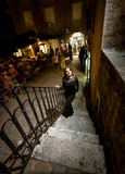 Night shot of woman in dress walking up the stairway on street Royalty Free Stock Images
