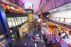 Night Siam Square One, Bangkok City, Thailand. BANGKOK - MARCH 17, 2016: A view of the facade of the Siam Square One and the Siam metro station. It is a shopping Stock Photos