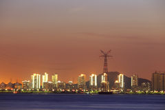Night sight of the electric tower in the sea Stock Photo