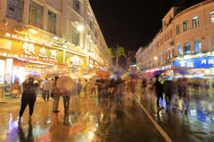 Night sight of zhongshan road in the rain, pedestrian and tourist Stock Photo