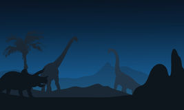 At night silhouette of Triceratops and brachiosaurus Royalty Free Stock Images