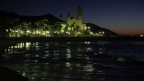 Night  of  Sitges with Church and sea stock video