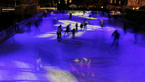 Night skating in outdoor ice park stock footage
