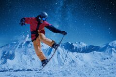Free Night Skating Snowboarder Doing Trick Under The Starry Sky And Moonlight Royalty Free Stock Photos - 173524378
