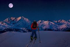Night ski with amazing view of swiss famous mountains in beautiful winter snow. The skituring, backcountry skiing in fresh powder royalty free stock photos