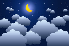 Night sky. With fluffy clouds and the moon shining