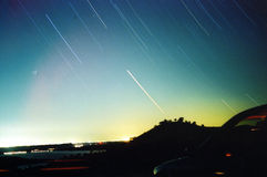 Night sky. Captured earth rotation Stock Photos