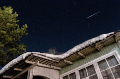 Night sky and asteroid. A night sky and an asteroid and a nearby house in the village Royalty Free Stock Photo