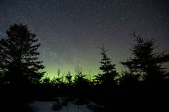 Night sky and aurora borealis in Perce stock photo