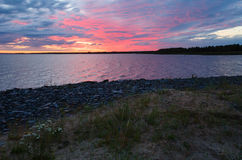 Night sky on the bay (Finland, polar day) Royalty Free Stock Photo