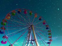 Night sky from the booth of the Ferris wheel. Good view of the starry sky Stock Image