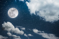 Night sky with bright full moon and cloudy, serenity nature back. Beautiful cloudscape with many stars. Night sky with bright full moon and cloudy, serenity blue Stock Photos