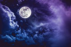 Night sky with bright full moon and cloudy, serenity nature back royalty free stock photography