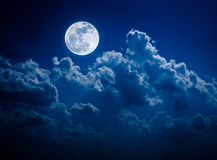 Night sky with bright full moon and cloudy, serenity nature back. Beautiful vivid skyscape. Landscape of night sky with bright full moon and cloudy, serenity stock image