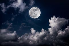 Night sky with bright full moon and cloudy, serenity nature back. Beautiful vivid skyscape. Landscape of night sky with bright full moon and cloudy, serenity royalty free stock photography