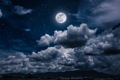 Night sky with bright full moon and dark cloud, serenity nature. Beautiful cloudscape with many stars. Night sky with bright full moon and dark cloudy above Stock Images