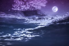Night sky with bright full moon and dark cloud, serenity nature Royalty Free Stock Image