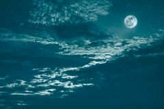 Night sky with bright full moon and dark cloud, serenity nature Royalty Free Stock Photos