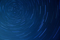 Night sky with bright star trails Stock Images