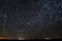 Night sky with bright stars trails. Astrophotography of outer sp. Ace stock photo
