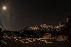 Night sky with clouds and stars passing by behind mountain Khumb. Ila, Dole village. Nepal Royalty Free Stock Image