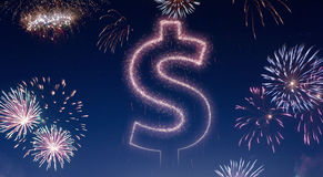 Night sky with fireworks shaped as a Dollar symbol.series. A dark night sky with a sparkling red firecracker in the shape of a Dollar symbol composed into.series Stock Image