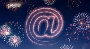 Night sky with fireworks shaped as an at symbol.series Royalty Free Stock Images