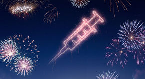 Night sky with fireworks shaped as a syringe.series Stock Image
